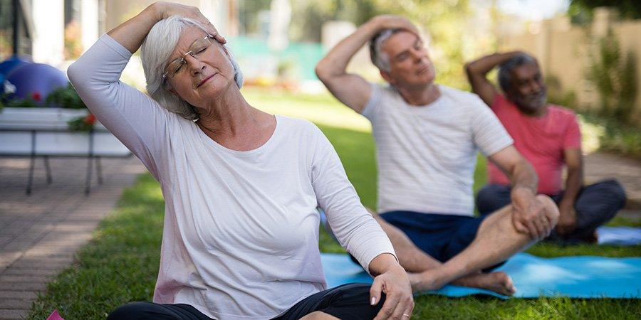 senior people stretching heads while exercising. cbd for migraines. Buy cbd edibles online.