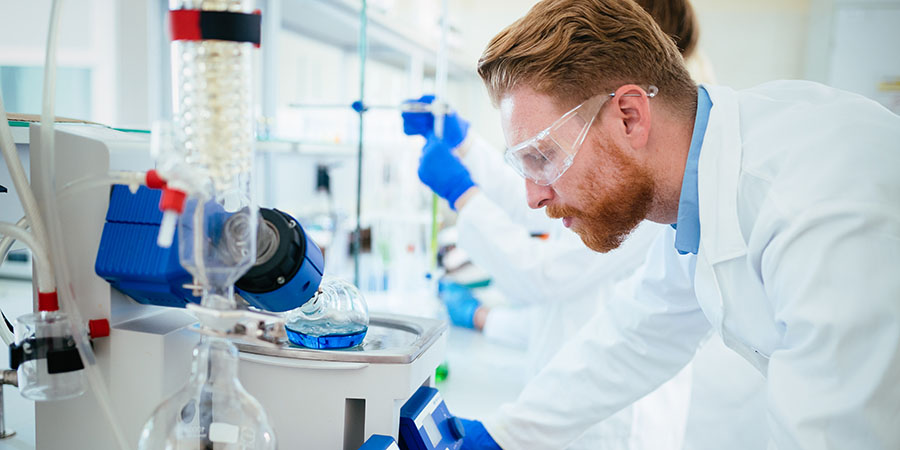 Scientists in a lab examining products