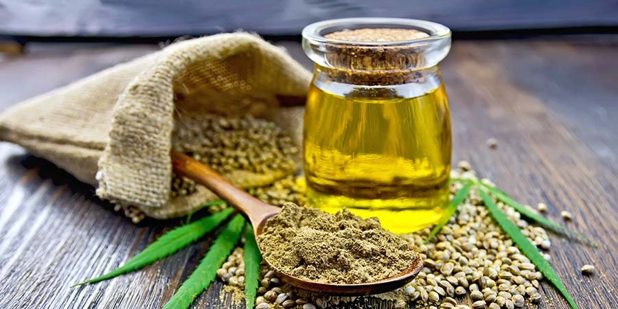 cbd oil tincture in a jar with hemps seeds. pure cbd oil tincture for sale. organic cbd tincture online USA.