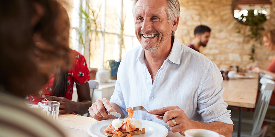 Mature couple having a meal. Buy delta 8 thc online USA.