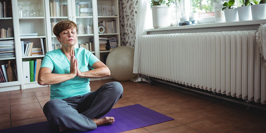 aldult woman in a yoga pose.