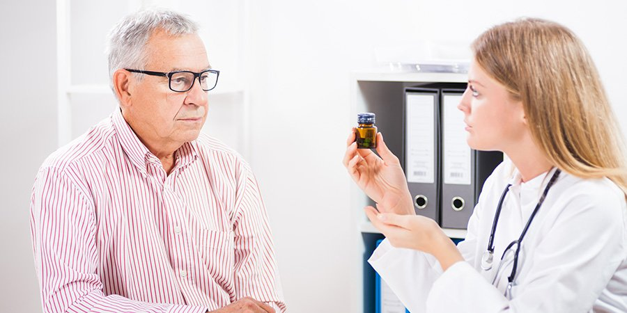 Doctor discussing delta 8 THC with an elderly male patient.
