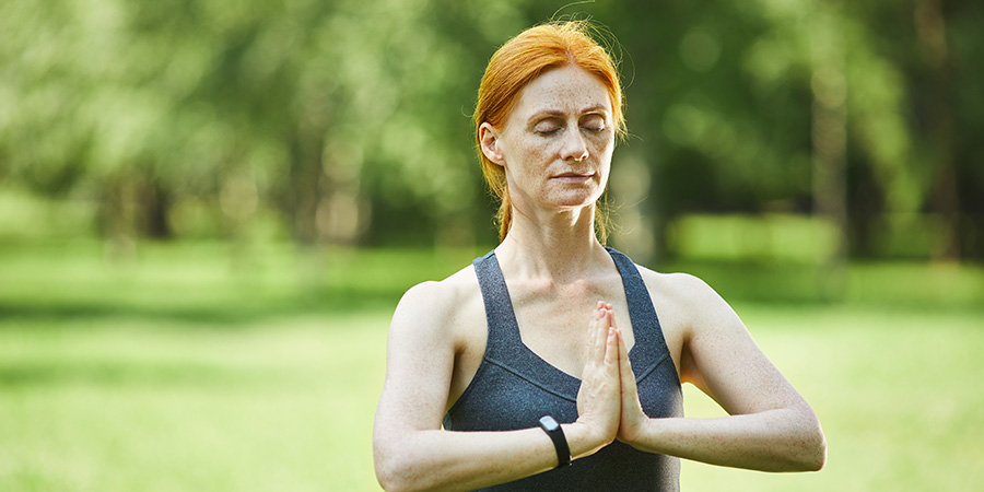Woman is yoga pose. where can you buy delta-8-THC online?