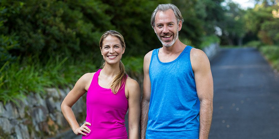 Adult couple posing for a photo after a run. Does cbd oil help with pain? How to use cbd oil for pain.