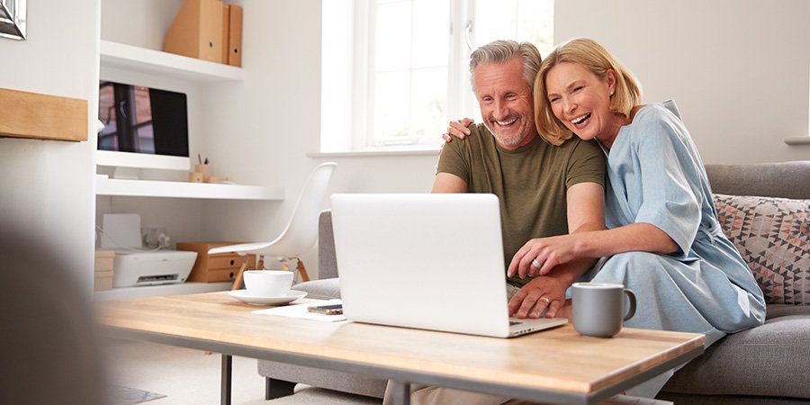 happy mature couple shopping online for cbd oil for nerve pain.