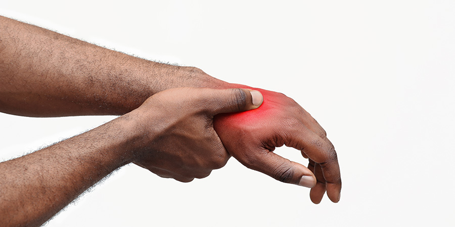 Adult man showing sign of nerve pain on his hand. info on using cbd for nerve pain in your brain. Is cbd oil used for nerve pain?
