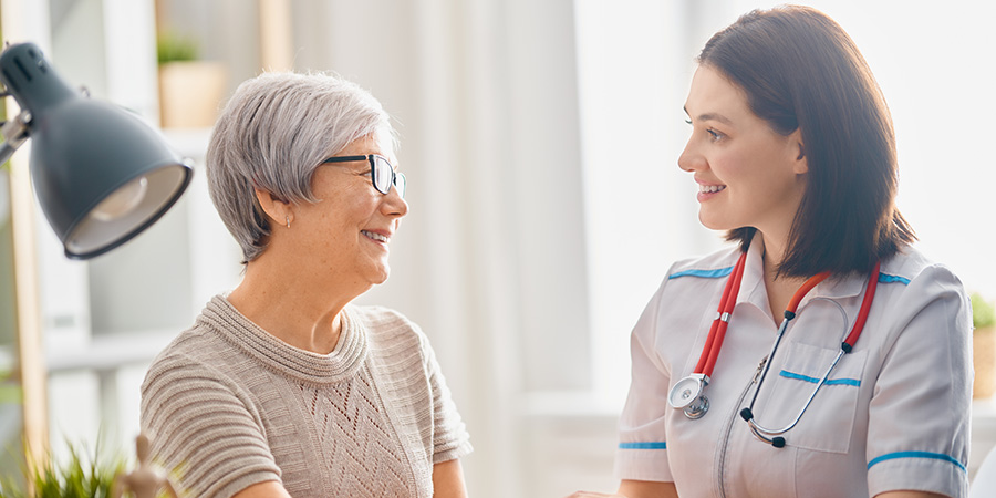 Woman being consulted by a doctor about using cbd for pain relief and inflammation.