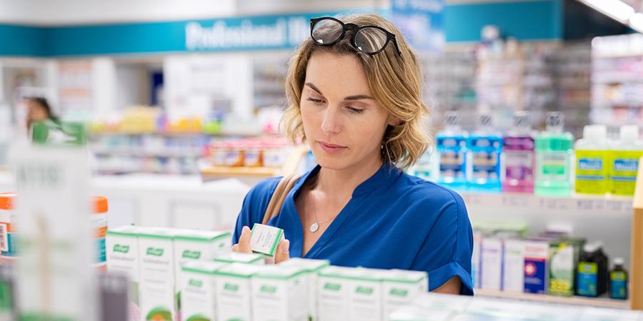 Adult woman shopping for an Urb Delta 8 Vape Cartridge.