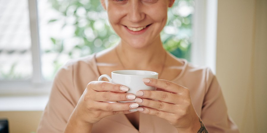 Woman enjoying Business meeting discussing where to buy Urb Delta 8 drops in here coffee.
