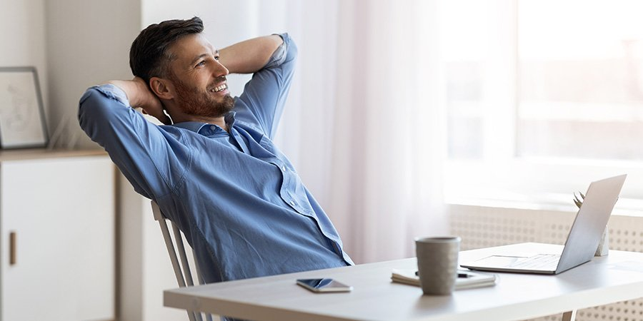 Man relaxing while working from home. buy owls delta 8 cartridges online. owls delta 8 cartridges reviews. reviews