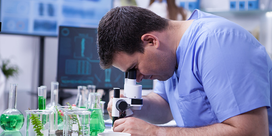 working in a lab with microscope. buy delta 8 THC vape carts online.