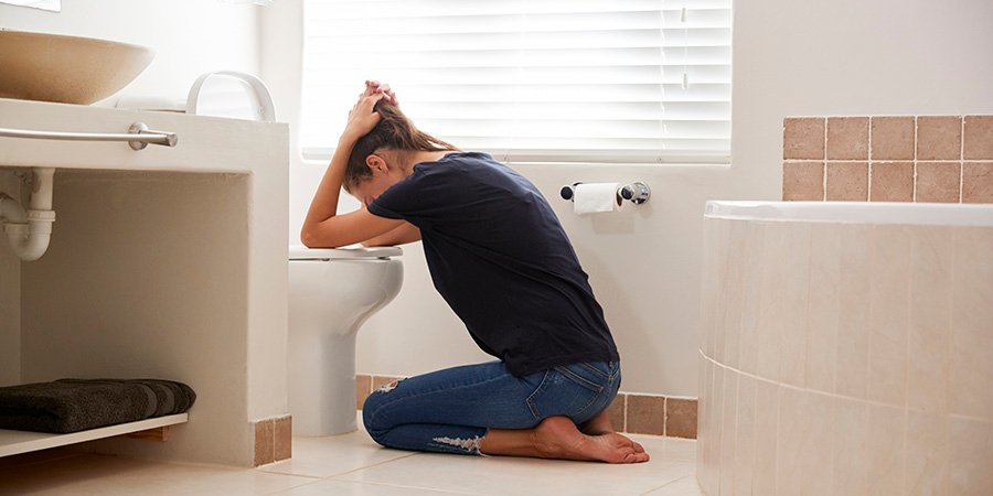 woman at the toilet with nausea. delta 8 distillate effects. buy delta-8 THC products online at greatcbdshop.com.