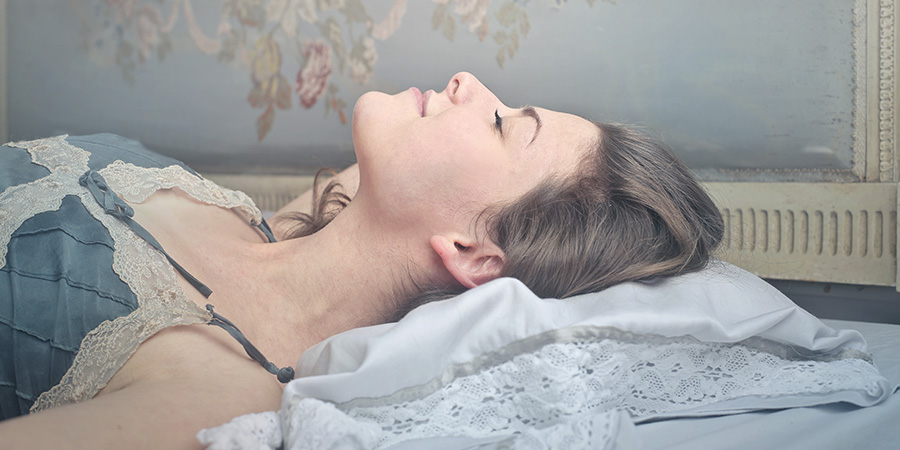 tranquil woman sleeping peacefully after dosing cbn for sleep