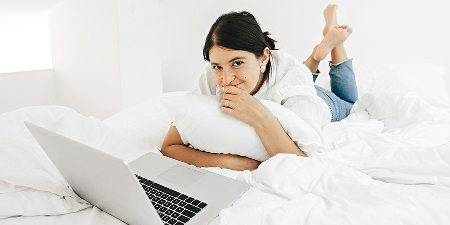 Happy stylish girl looking at laptop. What Is Delta-8 THC and How Is It Different from CBD?